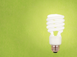 compact fluorescent bulb on green background