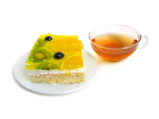 Delicious tart covered with fresh glazed fruits with tea