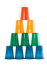 Pyramid from multi-coloured disposable plastic glasses