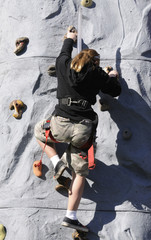 girl climbing artificial wall