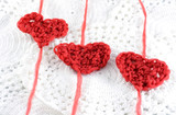 hearts with wool, done on a crochet hook poster