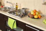 Detail of an modern kitchen with stove and fruits poster