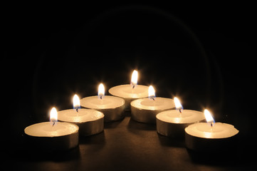 Candles lit arranged in a V formation