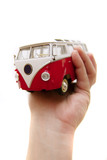 An old bus toy in hands