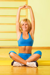 Beautiful young woman relaxing after fitness exercise