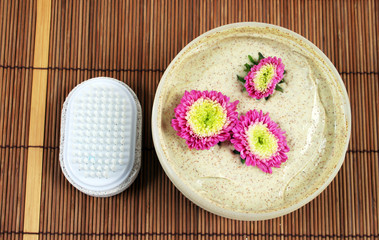 Spa and beauty products - body scrub and brush.