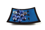 Oriental plate with blue healing stones - isolated. poster