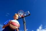 Fototapety Boy playing basketball