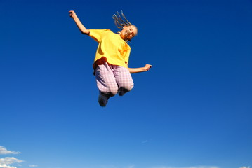 Teen girl jumping in air