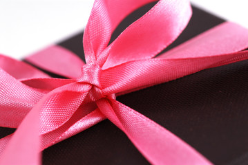 Close up shot of a gift box with Pink ribbons