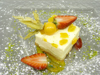 A peach cake with a fruits decoration