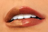 Macro image of bright lips. Red and gold lipstik poster