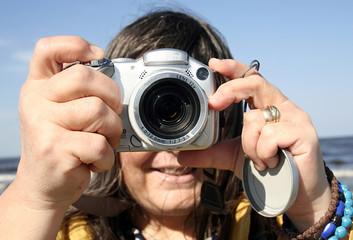 Close-up image of a photographer