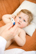 Doctor with baby and read thermometer. Focus point on a child