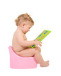 Pretty baby sit on pink potty and look to digits toy.