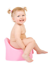 Pretty baby and pink potty . Isolate on white