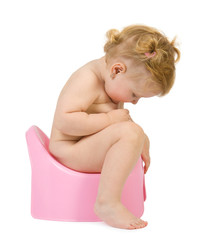 Pretty baby look in pink potty . Isolate on white