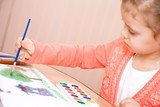 Pretty caucasian child watercolor paint . Focus point on a hand. poster