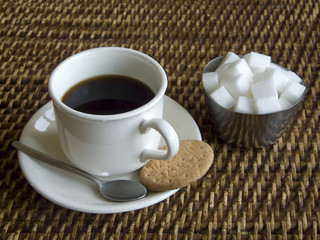 Coffee, biscuit and sugar