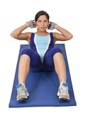 Image of a woman doing aerobics on a blue mat. poster