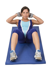 Image of a woman doing aerobics on a blue mat.