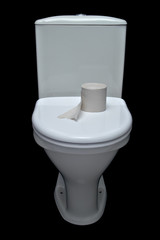 white iavatory pan with toilet paper on black background