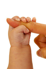 A baby is holding around its mothers finger.
