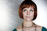 Sassy red head with a cute bob haircut on steel backdrop poster