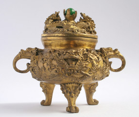 A traditional asian incense burner with a dragon head.