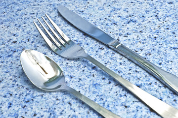 Silverware on Blue Granite