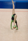 A female competitor in a Rhythmic Gymnastics event poster