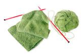 Knitting a green fluffy woollen scarf poster