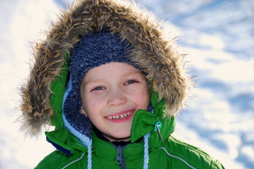 Child in winter coat smiling