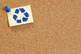 corkboard with recycle symbol on thumb tacked note poster
