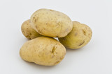 four young potatoes with gentle shadow on natural background poster