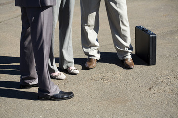 Shot of the lower legs and shoes of an architectural team