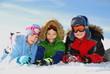 Children posing in snow gear