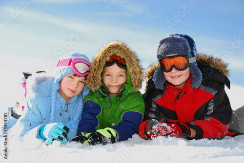 Children posing in snow gear