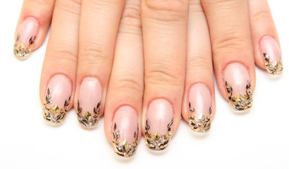 Manicure, women's hands with beautiful drawings on the nails