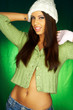 Portrait of beautiful woman wearing green sweater an white hat