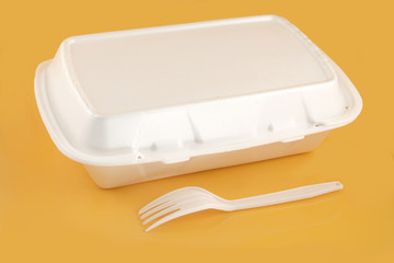 styrofoam take-out food container and plastic fork