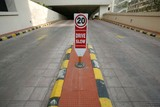 signage at elevated parking area, delhi, india poster