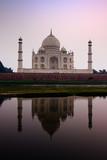The Taj Mahal mausoleum reflecting in the Yamuna river poster