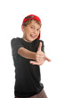 A boy giving the thumbs up hand sign, (focus to hand)