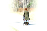 High contrast photo - woman during walking with pram poster