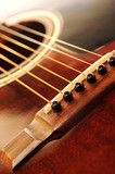 Acoustic guitar bridge and strings close up poster