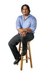 Hispanic Business Man Sitting on a Stool