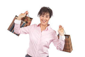 A woman holding shopping bags, isolated on white background