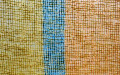 fuzzy orange and blue knit background
