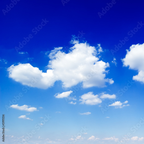 poster of The blue sky is covered by fluffy clouds.